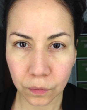 I may look unhappy (it was 3:30am!) but very happy with the way my skin felt and looked. Perfect canvas for foundation.
